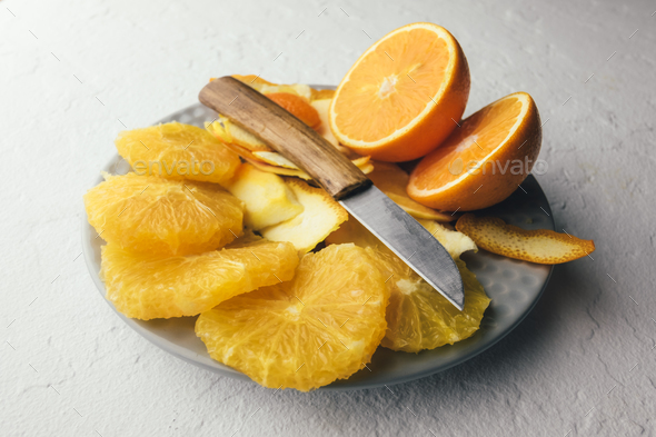 Orange pieces on grey plate closeup - Stock Photo - Images