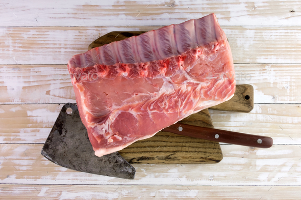Fresh raw pork piece on wooden board - Stock Photo - Images