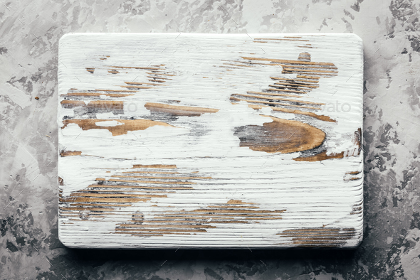 Old rustic white wood board on grunge concrete table - Stock Photo - Images