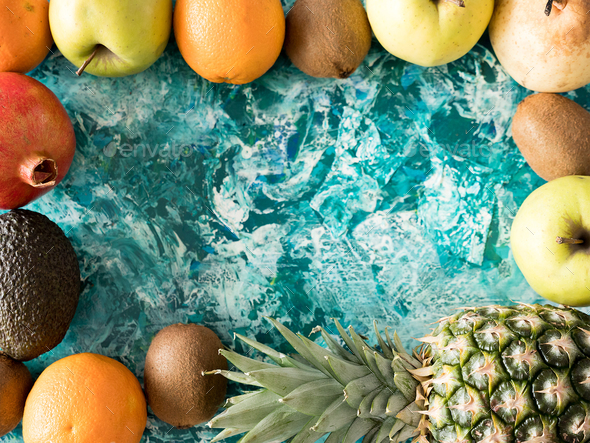 Top view of fruits on wooden background - Stock Photo - Images
