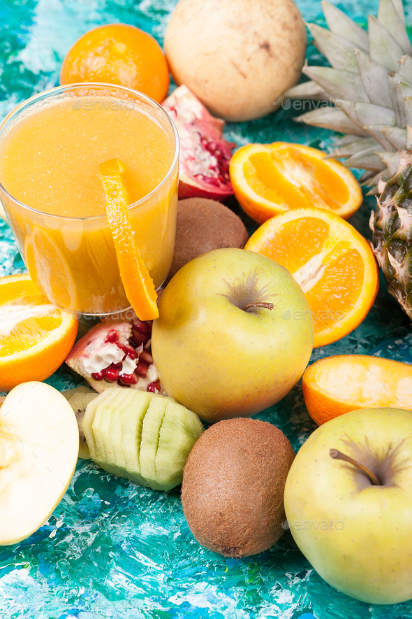 Close up of healthy and fresh fruits next to glass with detox ju - Stock Photo - Images