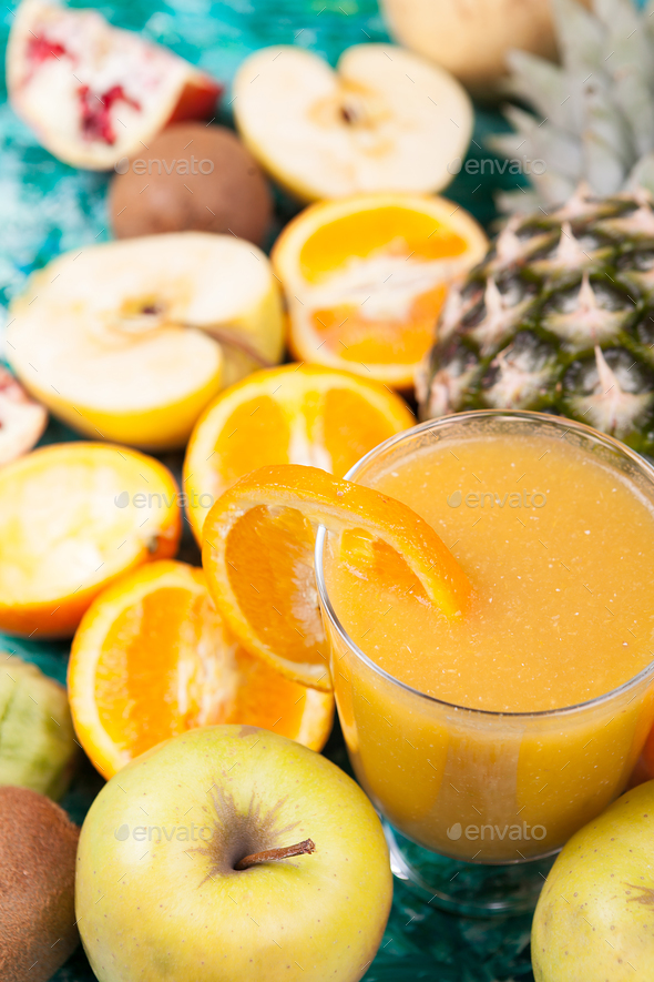 Detox smoothie surrounded by fruits it was made of - Stock Photo - Images