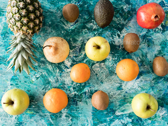 Different fresh fruits on wooden background - Stock Photo - Images