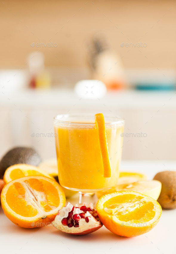 Fresh fruits, vegetables and smoothies in the kitchen - Stock Photo - Images