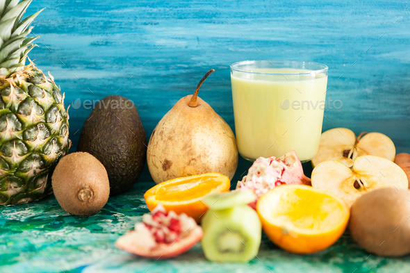 Glasses with organic and raw juices from vegetables and fruits - Stock Photo - Images