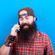 Happy man with long beard talking on the phone - PhotoDune Item for Sale