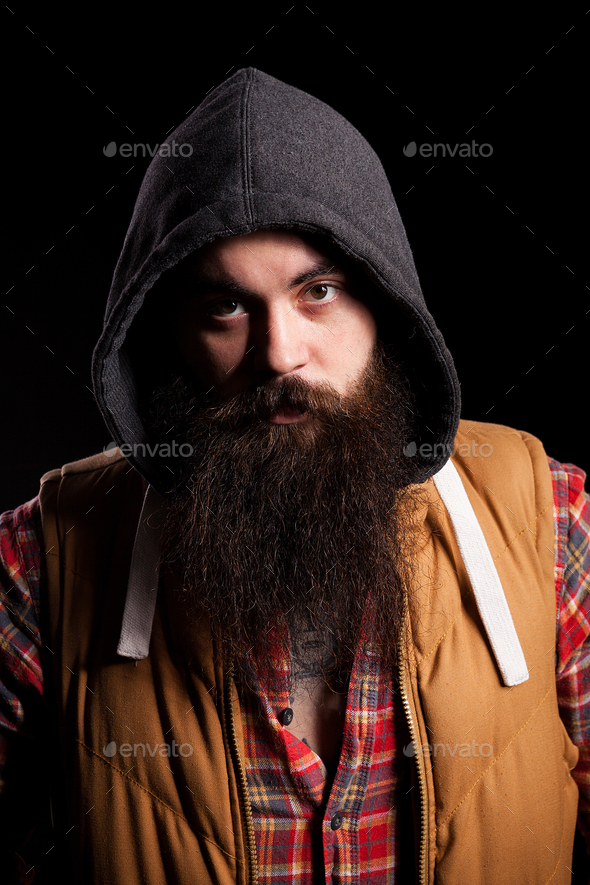 Hipster bearded man wearing a hood - Stock Photo - Images