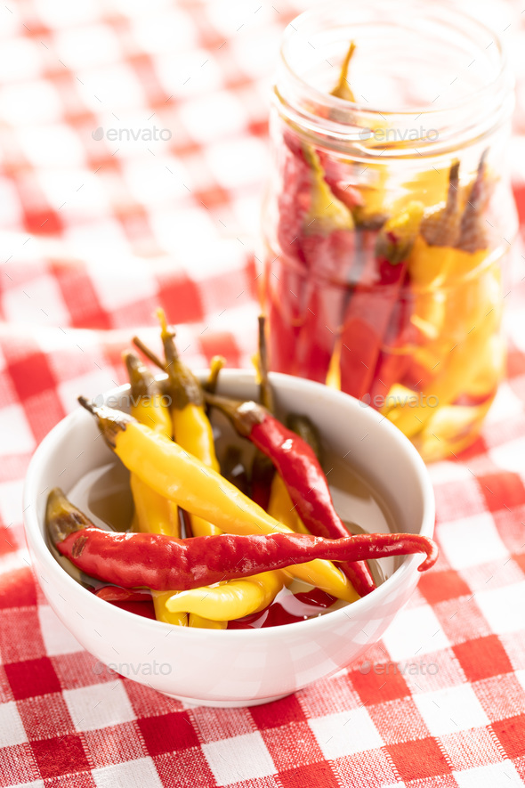 Pickled hot chili peppers. - Stock Photo - Images