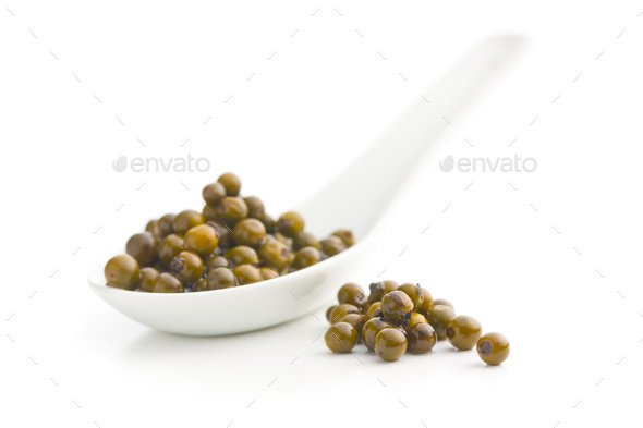 Green peppercorn in brine. - Stock Photo - Images