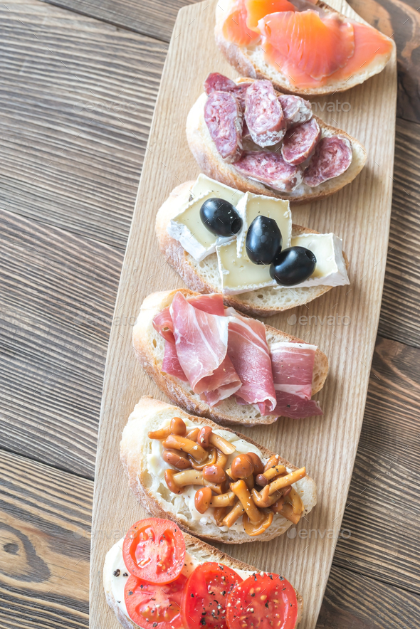 Crostini with different toppings - Stock Photo - Images