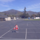 Kid practicing dribbling a basketball towards camera. - VideoHive Item for Sale