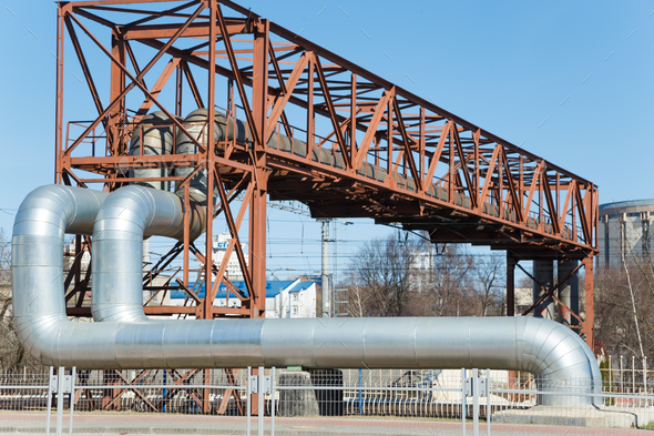 Industrial huge pipes on metal viaduct outdoor - Stock Photo - Images