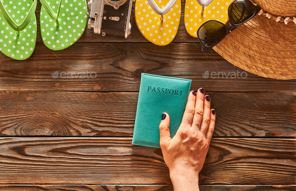 Woman planning a beach trip - Stock Photo - Images