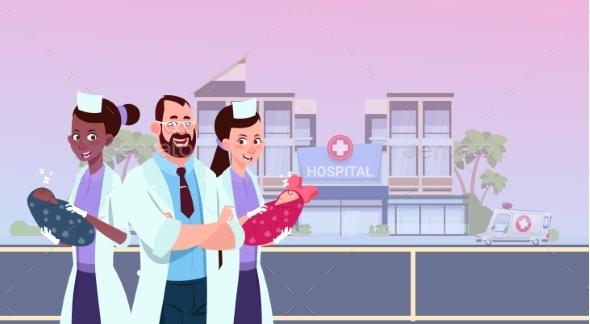 Nurses and Doctor Holding Newborn Children - Health/Medicine Conceptual
