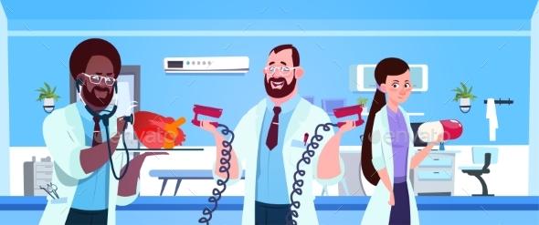 Team of Medical Doctors Holding Equipment - Health/Medicine Conceptual