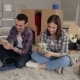 Couple Is Sitting in Apartment and Counting Money - VideoHive Item for Sale