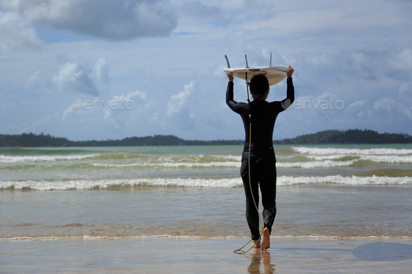 Going to surf in the ocean - Stock Photo - Images