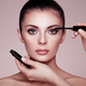 Beautiful brunette woman paints the eyelashes - PhotoDune Item for Sale