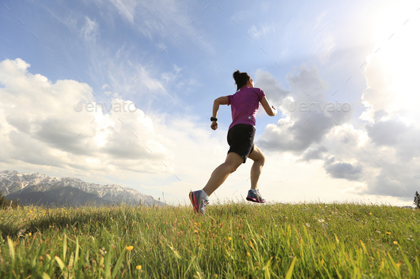 Trail running on mountain top - Stock Photo - Images
