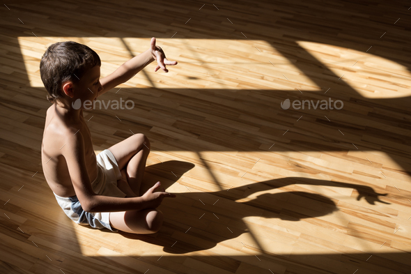 Charming little boy  playing  in theatre of shadows - Stock Photo - Images