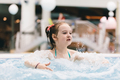 Little girl relaxing in a hot tub. - PhotoDune Item for Sale