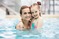 Young girl and her mother hugging in the pool. - PhotoDune Item for Sale