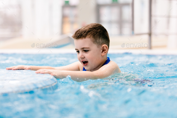 Young boy in a hot tub having fun, relaxing. - Stock Photo - Images