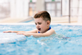 Young boy in a hot tub having fun, relaxing. - PhotoDune Item for Sale
