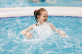 Little child enjoying her time in a hot tub. - PhotoDune Item for Sale