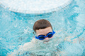 Kid in a swimming pool surfacing out of water - PhotoDune Item for Sale