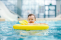 Little cute toddler swimming in a swim ring - PhotoDune Item for Sale