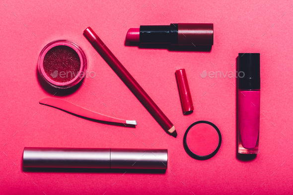 Beauty tools laying on a vivid pink background. - Stock Photo - Images