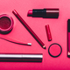 Beauty tools laying on a vivid pink background. - PhotoDune Item for Sale