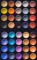 Colorful eyeshadow set on a black background. - PhotoDune Item for Sale