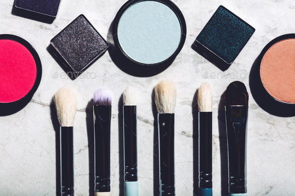 Makeup brushes and eyeshadows on a marble background - Stock Photo - Images