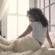 the Girl Woke Up and Sits on the Bed - VideoHive Item for Sale