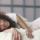 Cute Girl Wake Up and Lay in Bed. Portrait of Attractive Young Woman After Sleep - VideoHive Item for Sale