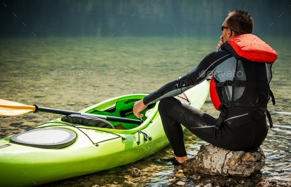 Tour Kayaker and the Lake - Stock Photo - Images