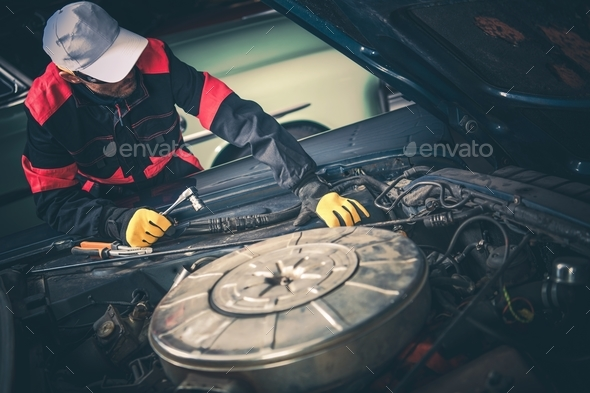Vintage Car Mechanic - Stock Photo - Images