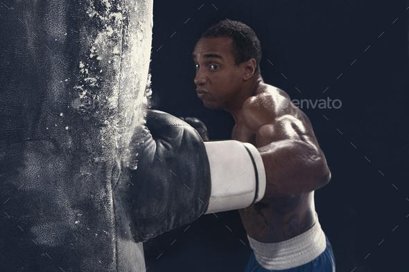 Boxing training and punching bag - Stock Photo - Images