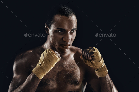 Afro man boxing and training over black background - Stock Photo - Images