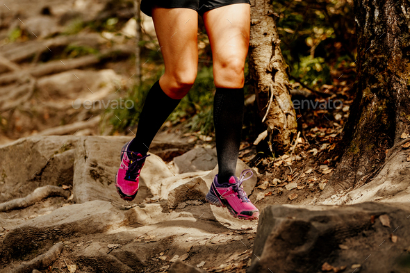 legs women runner in compression socks - Stock Photo - Images