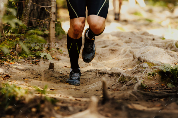 legs men runner in compression socks - Stock Photo - Images