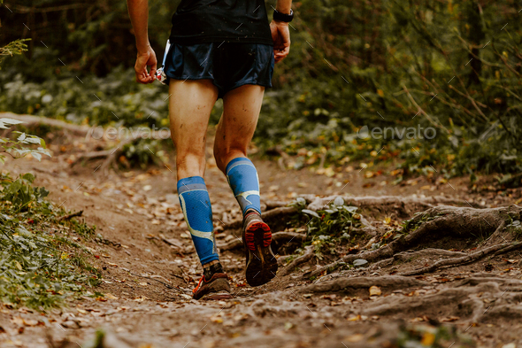 male runner in compression calf sleeves - Stock Photo - Images