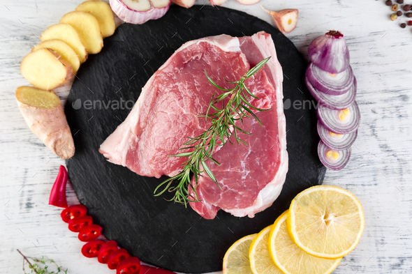 Raw pork meat with spice ingredient - Stock Photo - Images