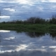 River in the Evening, a Wild River with a Blue Cloudy Sky - VideoHive Item for Sale