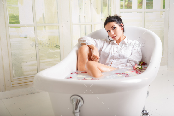Beautiful woman in the bathroom - Stock Photo - Images