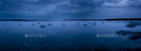 fog on glassy water with sailboats, panoramic shot. - Stock Photo - Images