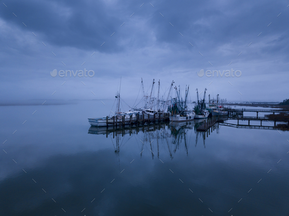 Low aerial view of shrimp boats in port in Port Royal, South Car - Stock Photo - Images