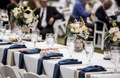 Table set up for wedding reception with people out of focus in b - PhotoDune Item for Sale